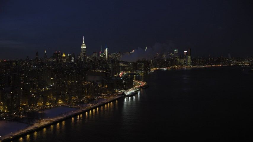 5K stock footage aerial video of the Midtown Manhattan skyline in winter, New York City, night Aerial Stock Footage | AX66_0411