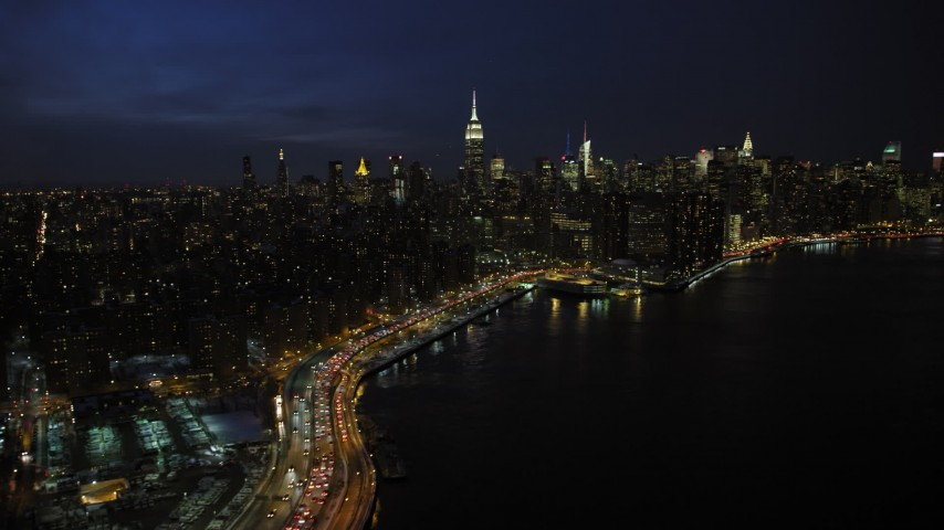 5K stock footage aerial video of a wide view of the Midtown Manhattan skyline, New York City, night Aerial Stock Footage | AX66_0413