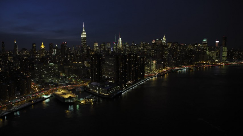5K stock footage aerial video of tall Midtown Manhattan skyscrapers, New York City, night Aerial Stock Footage | AX66_0414
