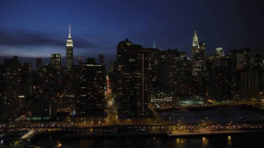 5K aerial video passing Midtown Manhattan skyscrapers, New York City, night Aerial Stock Footage | AX66_0417
