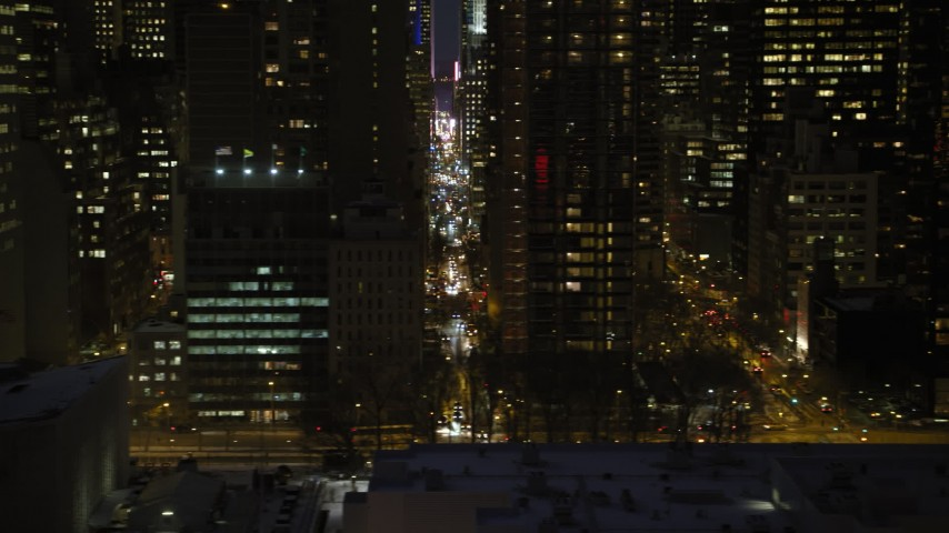 5K stock footage aerial video of Midtown Manhattan city streets, New York City, night Aerial Stock Footage | AX66_0419