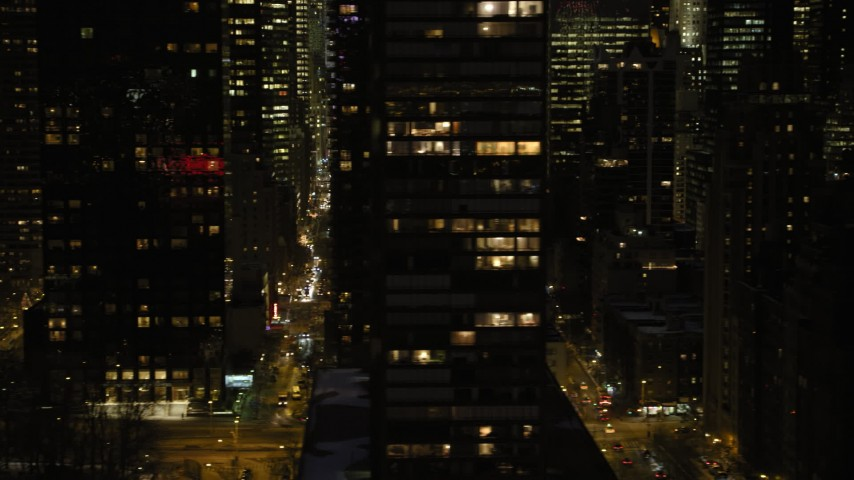 5K stock footage aerial video flyby Midtown Manhattan city streets, New York City, night Aerial Stock Footage | AX66_0420