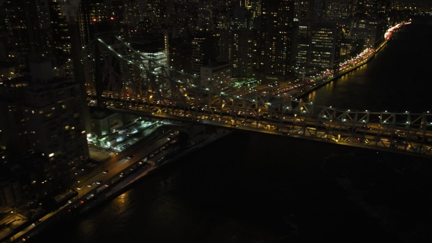 Queensboro Bridge and Midtown Manhattan Skyscrapers, New York City Night Aerial Stock Footage | AX66_0422
