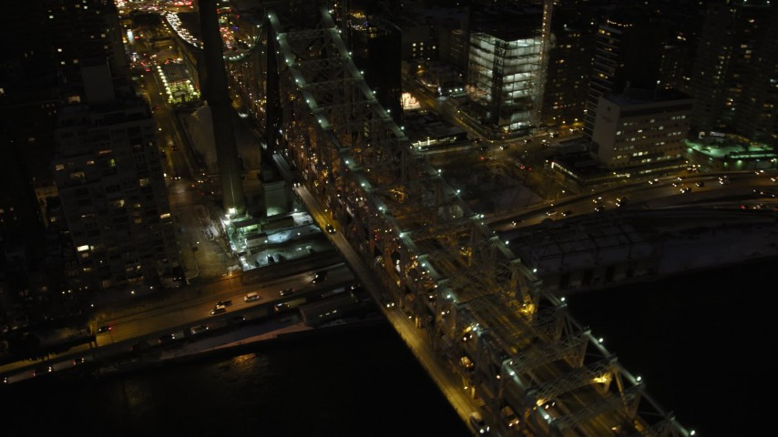 5K stock footage aerial video of Queensboro Bridge and Midtown Manhattan skyscrapers, New York City, night Aerial Stock Footage | AX66_0422