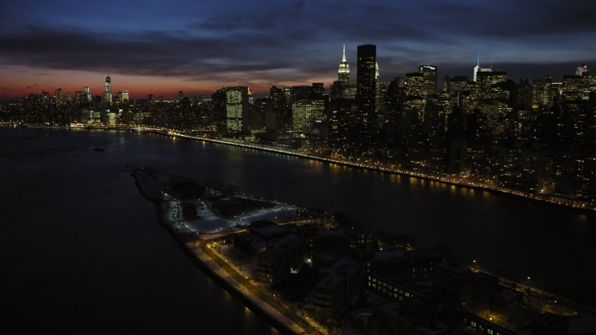 5K stock footage aerial video of Midtown Manhattan skyscrapers and Roosevelt Island, New York City, night Aerial Stock Footage | AX66_0425