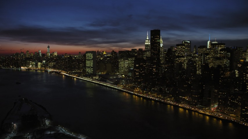 5K stock footage aerial video approach Midtown Manhattan skyline, New York City, night Aerial Stock Footage | AX66_0426
