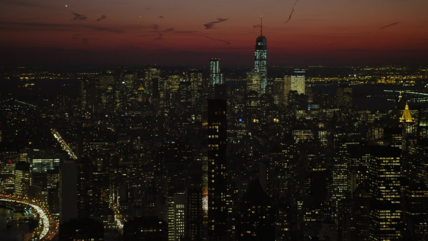 Lower Manhattan skyscrapers and Chrysler Building, New York City Night Aerial Stock Footage | AX66_0428