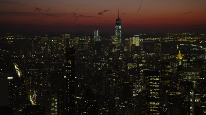 5K stock footage aerial video of Lower Manhattan skyscrapers seen from Chrysler Building, New York City, night Aerial Stock Footage | AX66_0428