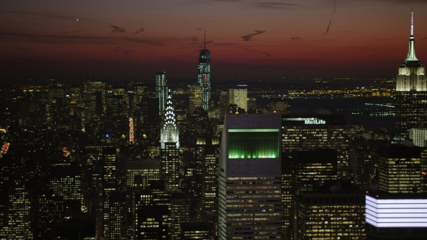 5K stock footage aerial video of Lower Manhattan skyscrapers, Chrysler, and Empire State Building, New York City, night Aerial Stock Footage | AX66_0429