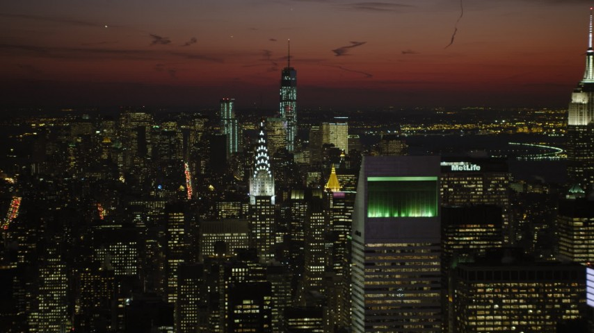 Lower Manhattan skyscrapers and Chrysler and Empire State Building, New York City Night Aerial Stock Footage | AX66_0430