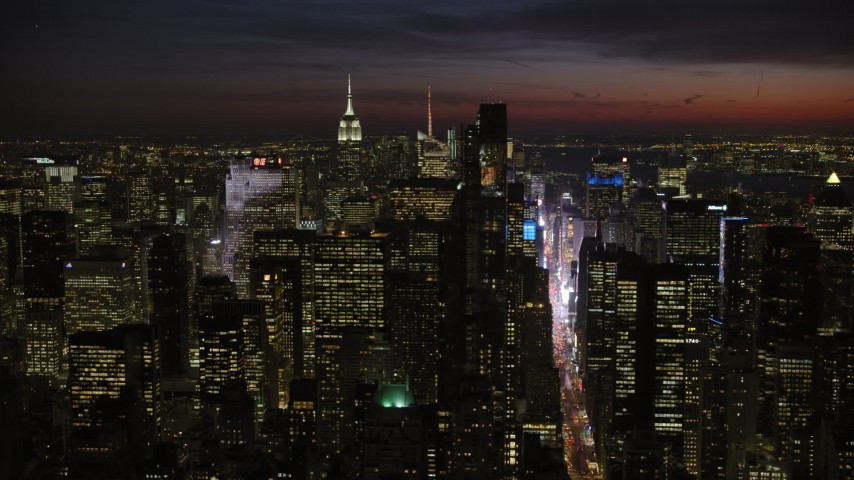 5K stock footage aerial video of Midtown Manhattan skyscrapers, New York City, night Aerial Stock Footage | AX66_0432
