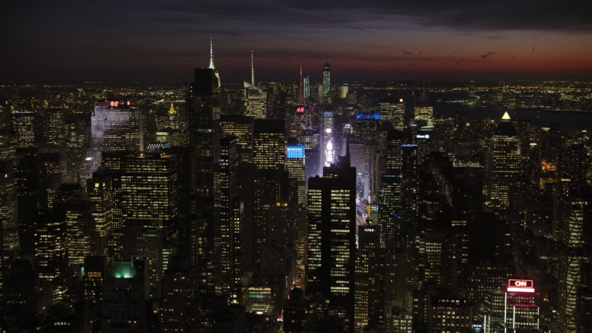 Times Square and Midtown Manhattan skyscrapers, New York City Night Aerial Stock Footage | AX66_0433