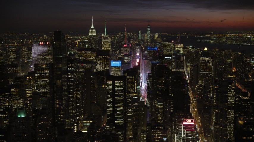 5K aerial video of Times Square and Midtown Manhattan skyscrapers, New York City, night Aerial Stock Footage | AX66_0433