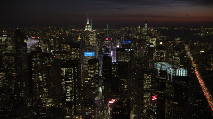 5K stock footage aerial video of Midtown Manhattan skyscrapers and Times Square, New York City, night Aerial Stock Footage | AX66_0434