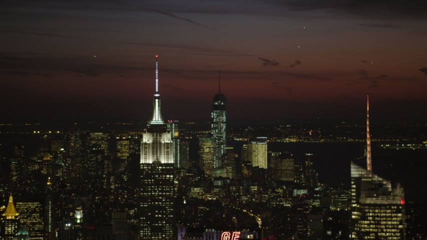 Empire State Building and Lower Manhattan skyscrapers, New York City Night Aerial Stock Footage   AX66_0437