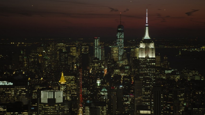 5K stock footage aerial video of Empire State Building and Lower Manhattan skyscrapers, New York City, night Aerial Stock Footage | AX66_0437