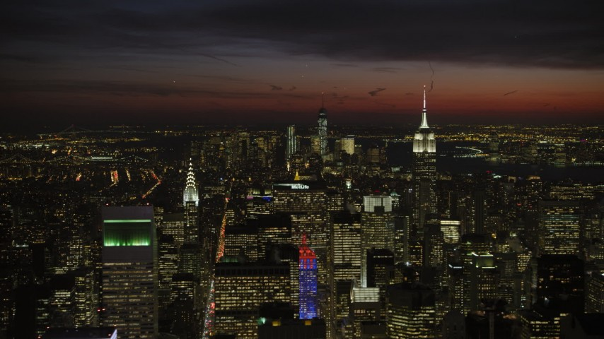 Empire State and Chrysler Building, New York City Night Aerial Stock Footage AX66_0438