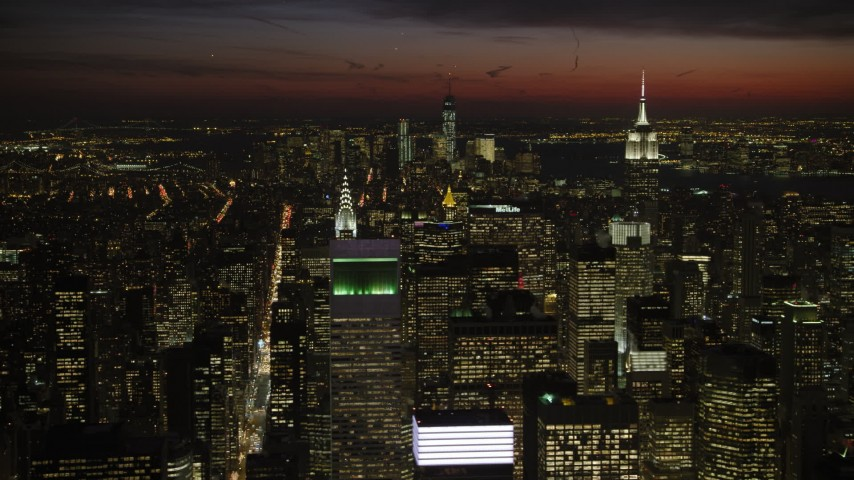 5K stock footage aerial video of Empire State and Chrysler Buildings, and Lower Manhattan, New York City, night Aerial Stock Footage | AX66_0438