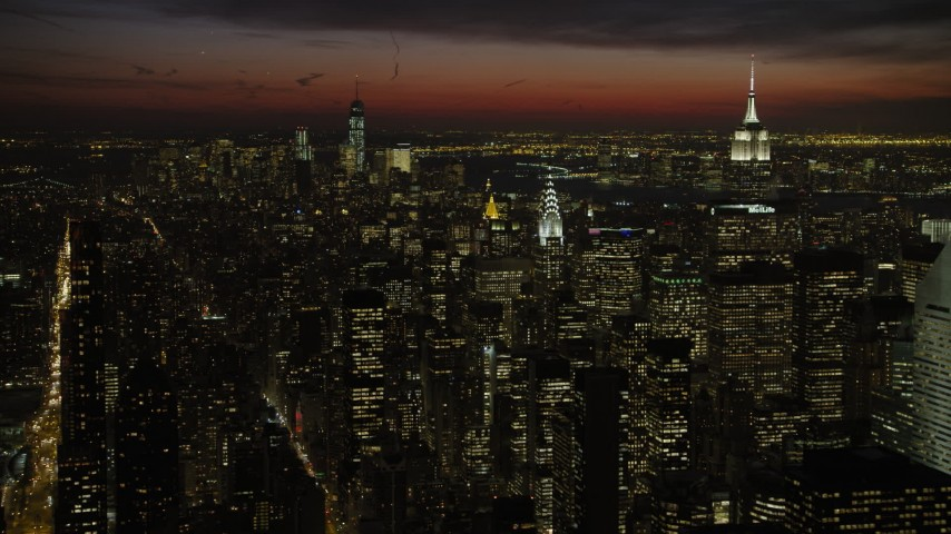 5K stock footage aerial video of Empire State and Chrysler Building with view of Lower Manhattan skyscrapers, New York City, night Aerial Stock Footage | AX66_0439