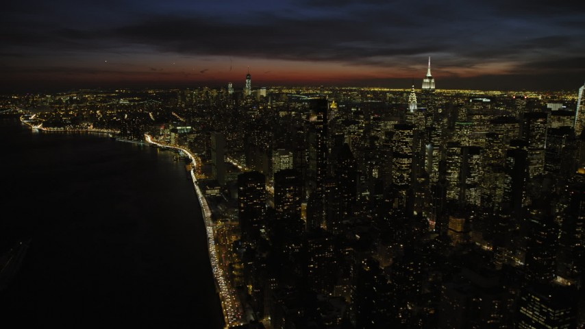 Midtown and Lower Manhattan skyscrapers, New York City Night Aerial Stock Footage | AX66_0440
