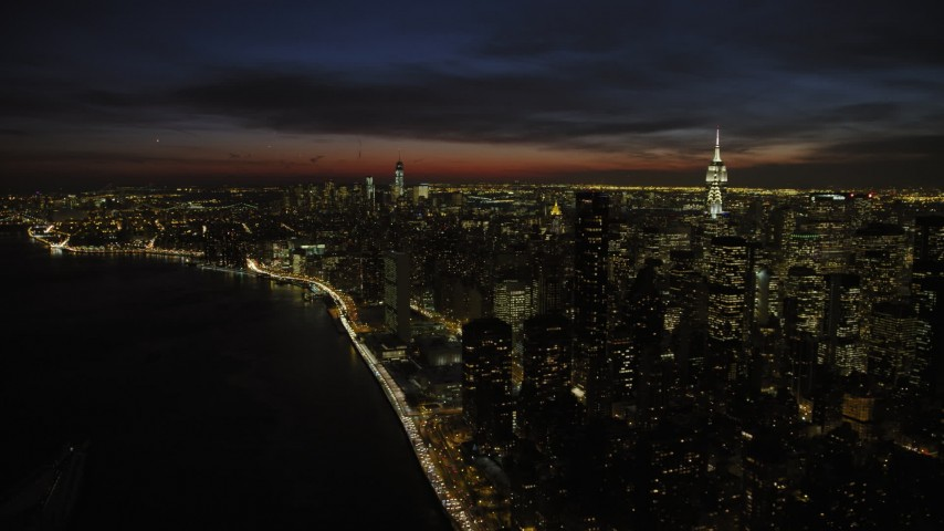 5K stock footage aerial video of a view of Midtown and Lower Manhattan skyscrapers, New York City, night Aerial Stock Footage | AX66_0440