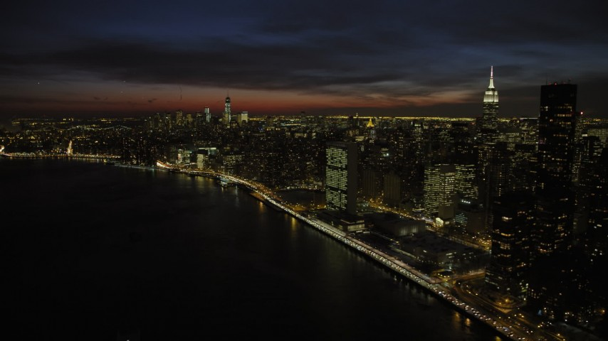 5K stock footage aerial video of United Nations Building and Midtown Manhattan, New York City, night Aerial Stock Footage | AX66_0441