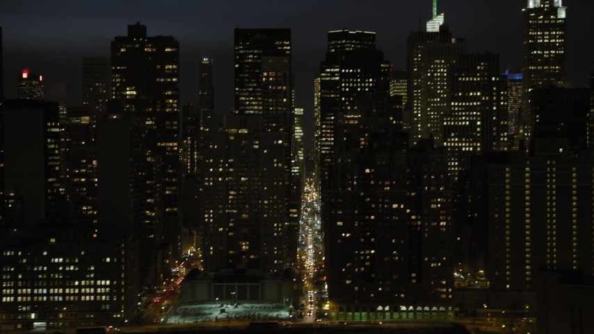 5K stock footage aerial video of Midtown Manhattan skyscrapers and streets, New York City, night Aerial Stock Footage | AX66_0444