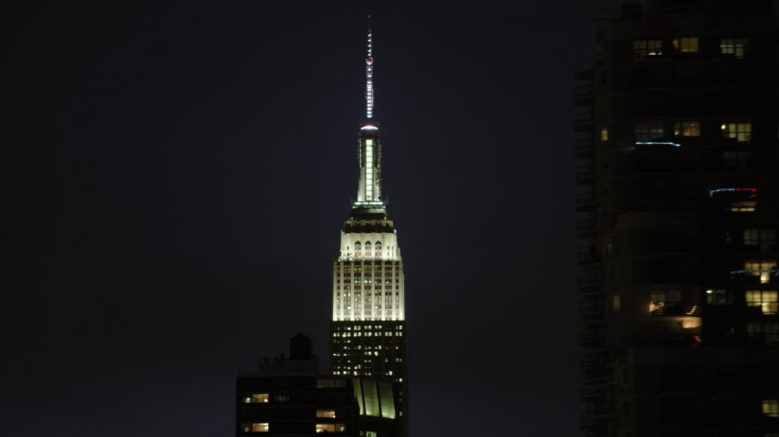 5K stock footage aerial video reveal Empire State Building in Midtown Manhattan,  New York City, night Aerial Stock Footage | AX66_0446