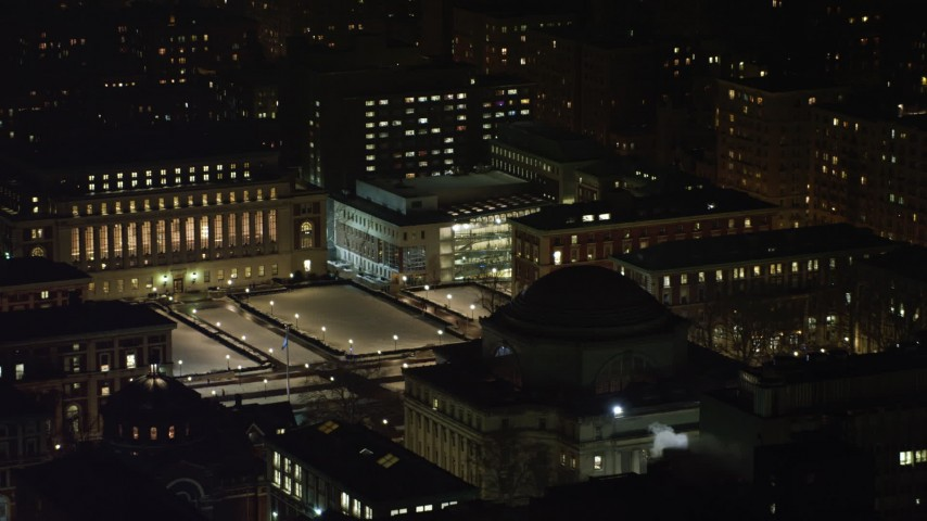 4K stock video aerial view approach Library and Lerner Hall at snowy Columbia University at night, New York City, New York Aerial Stock Footage | AX67_0009