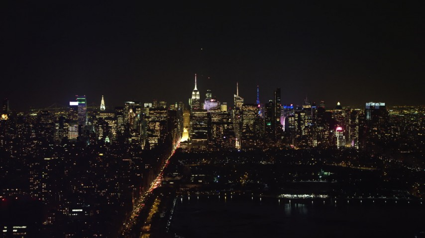 4K stock video aerial view of a view of the Midtown Manhattan skyline at night, New York City, New York Aerial Stock Footage | AX67_0012