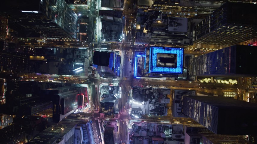4K stock video aerial view of tilting to a bird's eye view of bright lights of Time Square in New York City, New York Aerial Stock Footage | AX67_0024