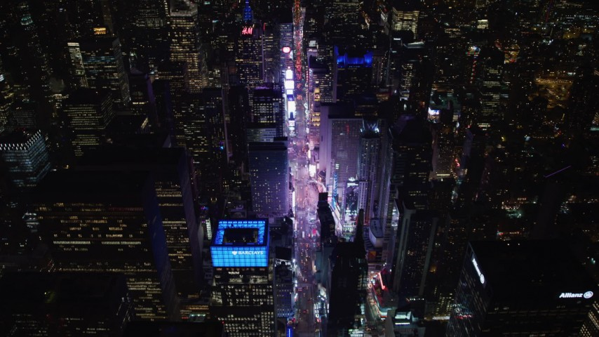4K stock video aerial view follow 7th Avenue to approach Times Square at night, Midtown Manhattan, New York City, New York Aerial Stock Footage | AX67_0028
