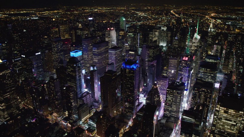 4K stock video aerial view circling the bright lights of Times Square at night, Midtown Manhattan, New York City, New York Aerial Stock Footage | AX67_0031
