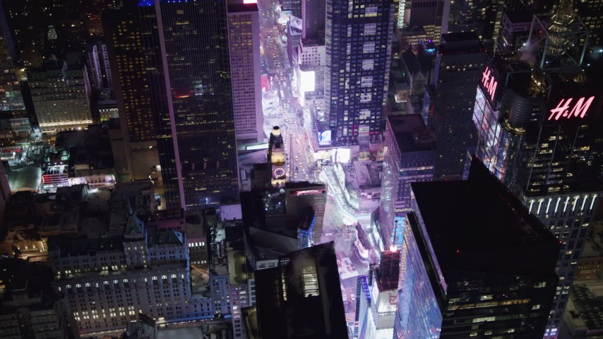 4K stock video aerial view orbit Times Square and skyscrapers at night in Midtown Manhattan, New York City, New York Aerial Stock Footage | AX67_0035