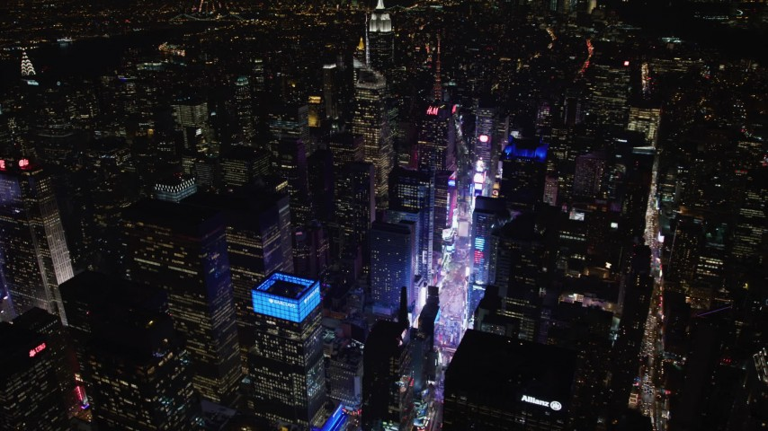 4K stock video aerial view tilt from Times Square to reveal Empire State Building at night, Midtown Manhattan, New York City, New York Aerial Stock Footage | AX67_0036