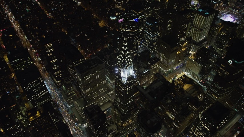 4K stock video aerial view approach Chrysler Building and tilt to bird's eye view at night in Midtown Manhattan, New York City, New York Aerial Stock Footage | AX67_0038