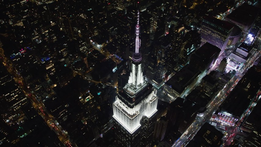 4K stock video aerial view approach the Empire State Building at night, Midtown Manhattan, New York City, New York Aerial Stock Footage | AX67_0039
