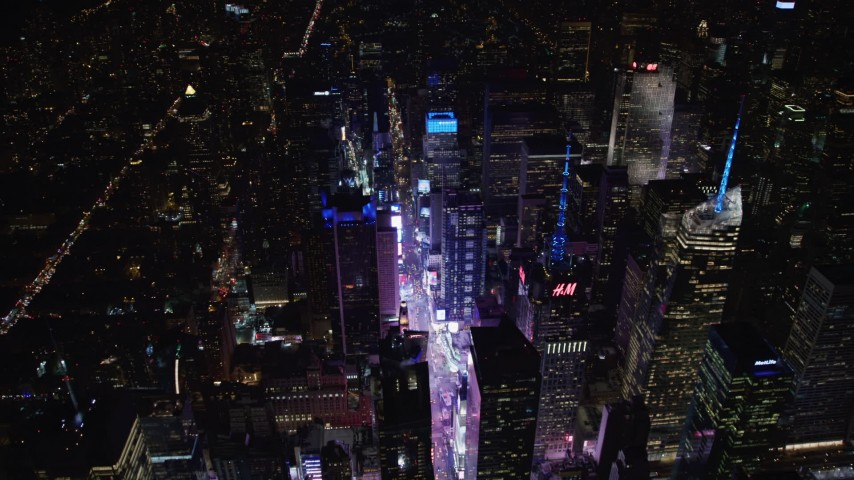 4K stock video aerial view flyby Times Square and skyscrapers at night, Midtown Manhattan, New York City, New York Aerial Stock Footage | AX67_0040