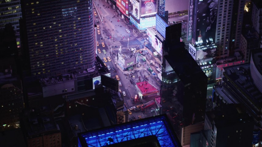 4K stock video aerial view of tourists visiting Times Square at night, Midtown Manhattan, New York City, New York Aerial Stock Footage | AX67_0042