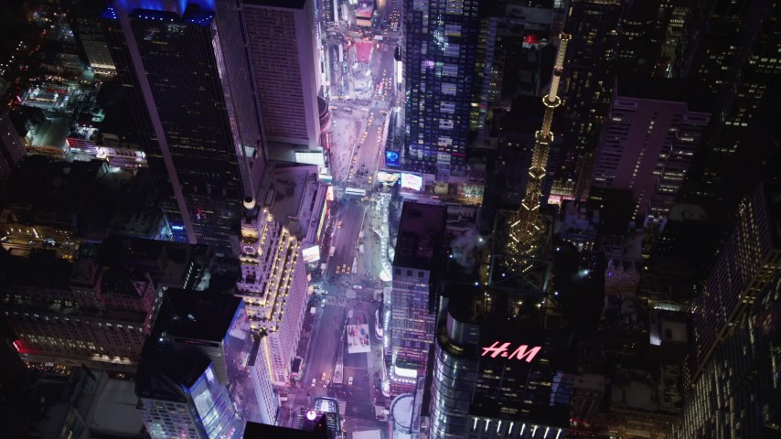 4K stock video aerial view of looking down on Times Square at night, Midtown Manhattan, New York City, New York Aerial Stock Footage | AX67_0044