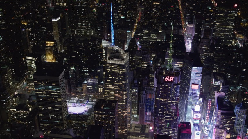 4K stock video aerial view of orbiting Bank of America Tower and fly away at night, Midtown Manhattan, New York City, New York Aerial Stock Footage | AX67_0045