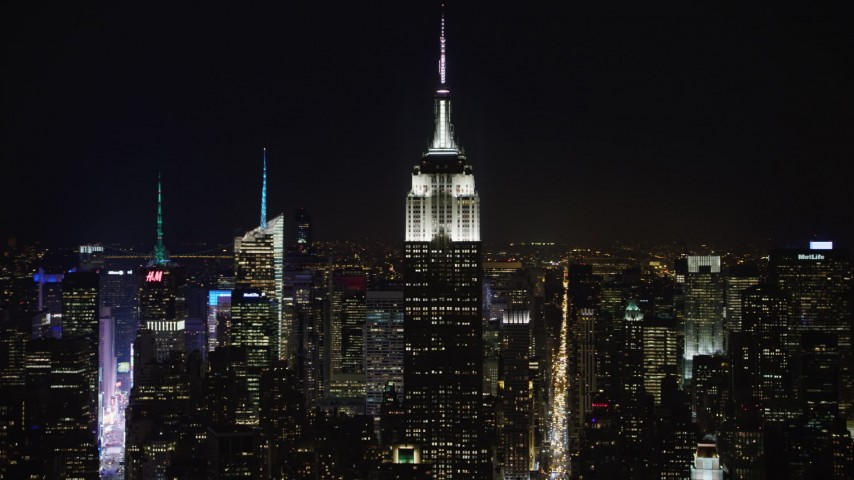 4K stock video aerial view of the Empire State Building and Midtown skyscrapers at night, Midtown Manhattan, New York City, New York Aerial Stock Footage | AX67_0049