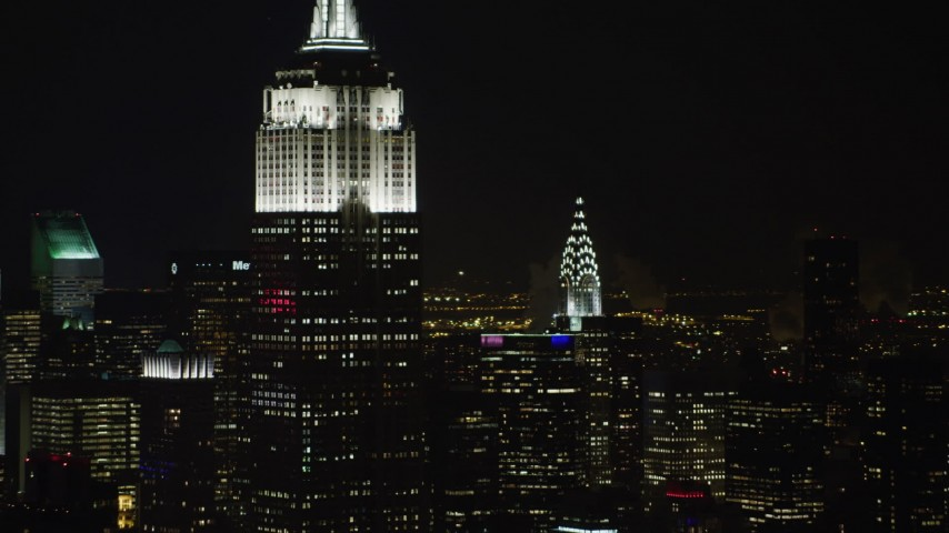 4K stock video aerial view flyby the Empire State Building and Chrysler Building at night, Midtown Manhattan, New York City, New York Aerial Stock Footage | AX67_0050