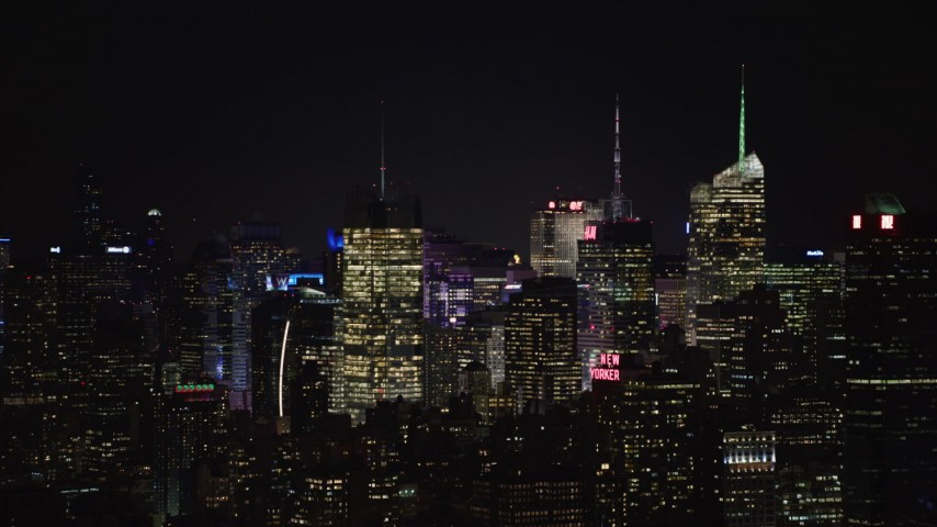 4K stock video aerial view a group of towering skyscrapers at night, Midtown Manhattan, New York City, New York Aerial Stock Footage | AX67_0051