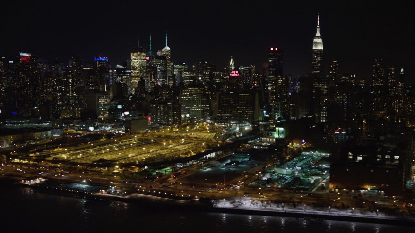 4K stock video aerial view of Hudson Yards and Hell's Kitchen skyscrapers at night, Midtown Manhattan, New York City Aerial Stock Footage | AX67_0052
