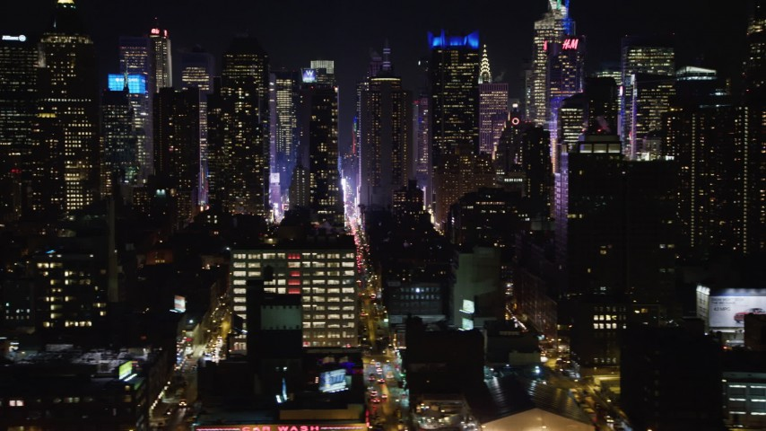 4K stock video aerial view of flying by Hell's Kitchen skyscrapers at night, Midtown Manhattan, New York City, New York Aerial Stock Footage | AX67_0055