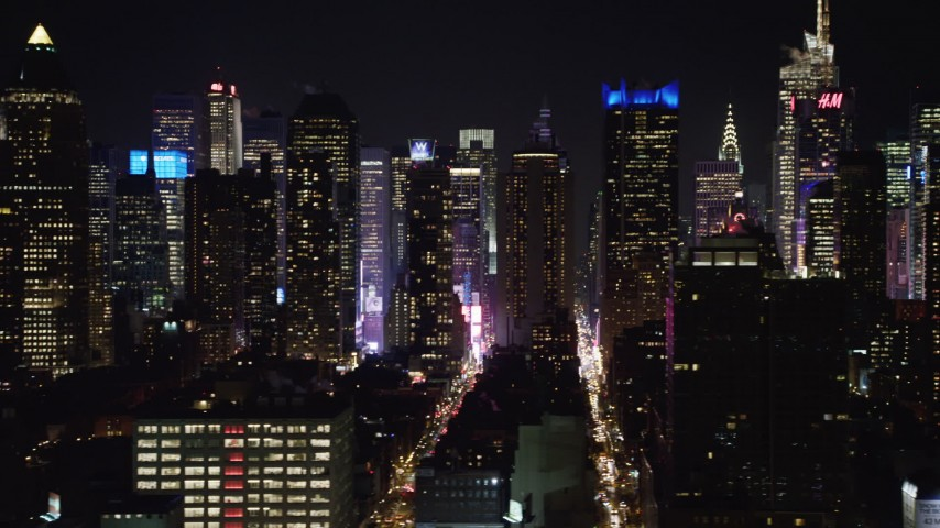 4K stock video aerial view of flying by Hell's Kitchen area of Midtown Manhattan at night, New York Aerial Stock Footage | AX67_0059