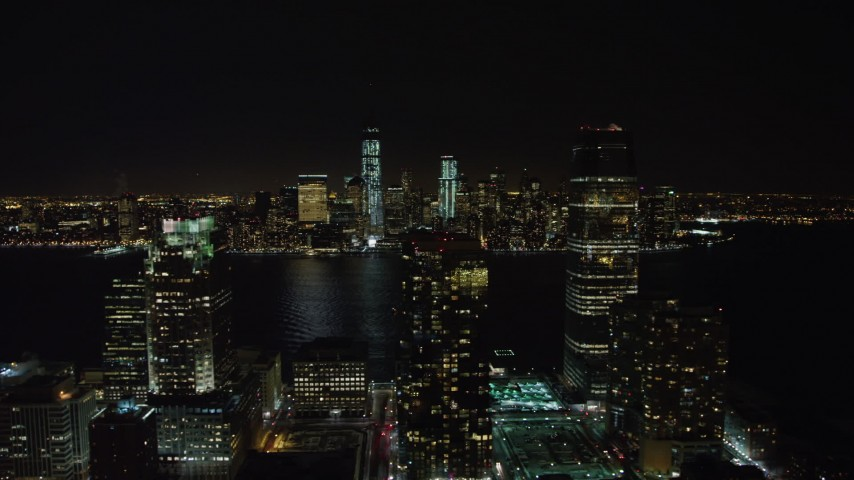 4K stock video aerial view of World Trade Center and Freedom Tower seen from Goldman Sachs Tower at night, New York Aerial Stock Footage | AX67_0071