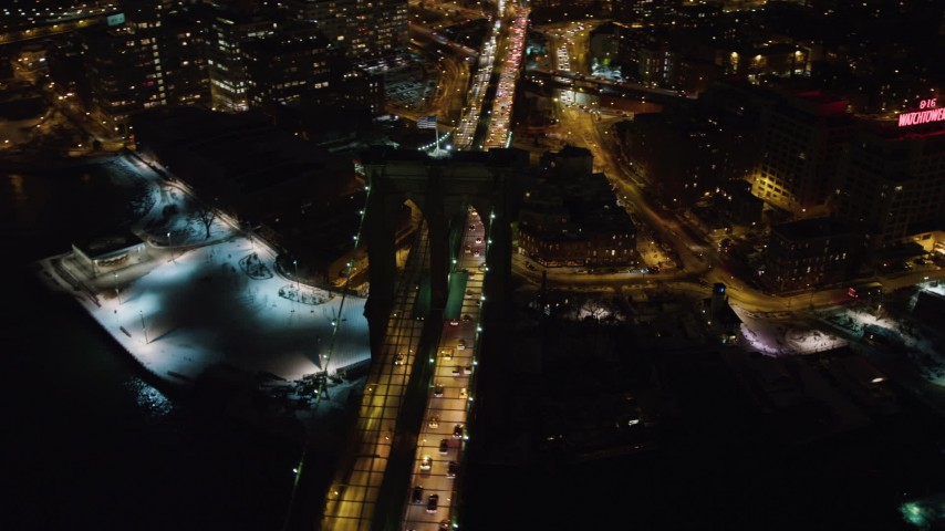 4K stock video aerial view of flying by Brooklyn Bridge at night, New York Aerial Stock Footage | AX67_0078