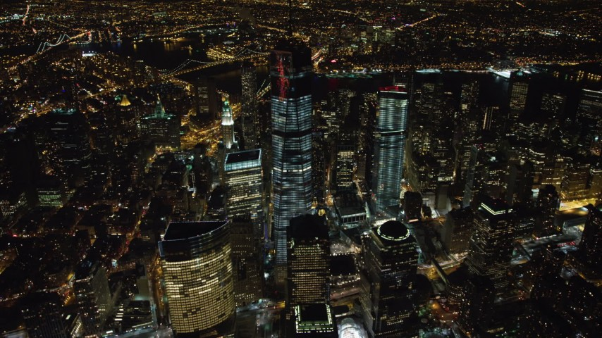 4K stock video aerial view of orbiting One World Trade Center in Lower Manhattan at night, New York Aerial Stock Footage | AX67_0086